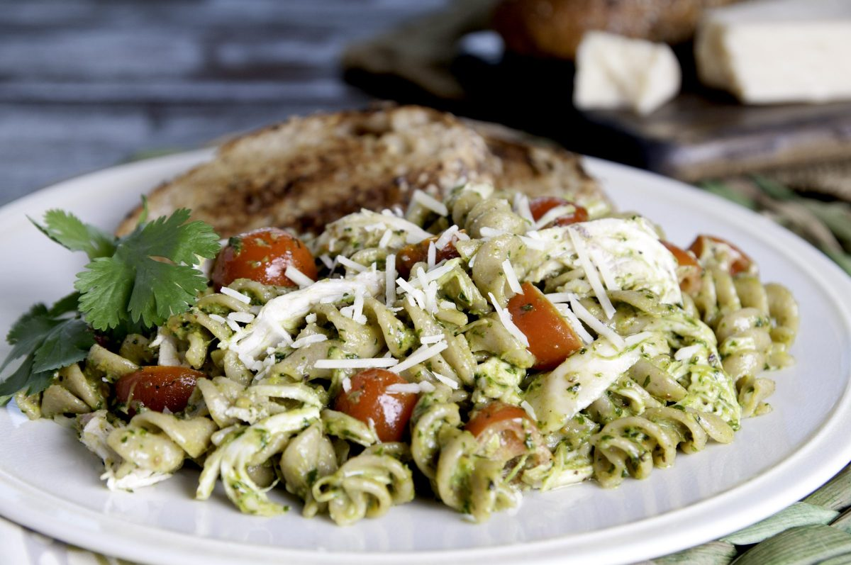 Cilantro Pesto Pasta with Chicken served with whole wheat toast and a sprig of basil