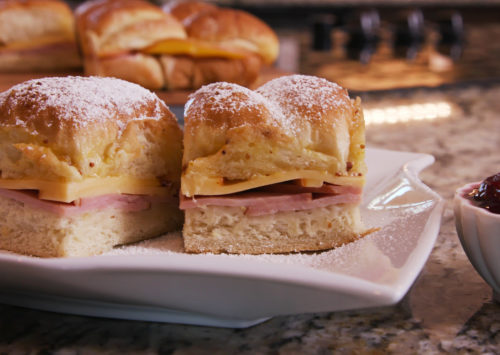 Monte Cristo Sliders served on a plate complete with raspberry jelly.