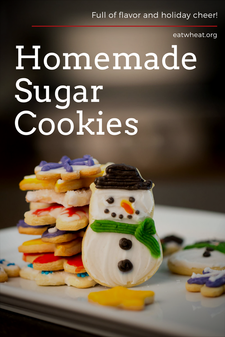 Sugar cookies cut out into snowmen and snowflakes