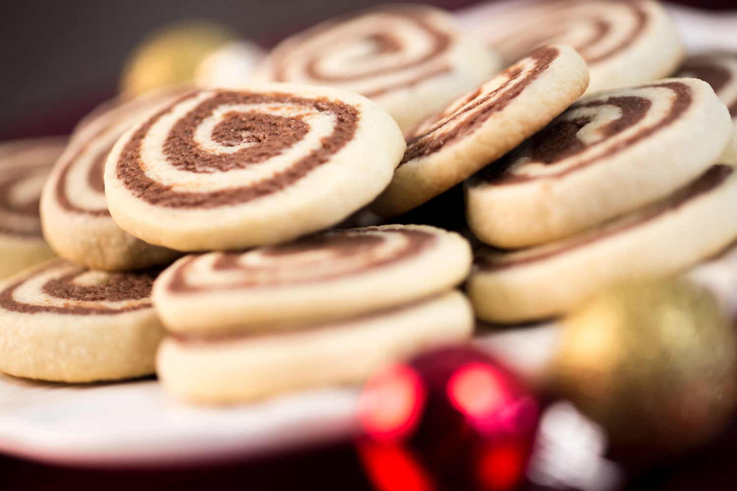 Chocolate Pinwheel Cookies stacked and ready to be given as Christmas gifts