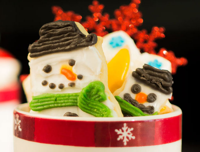 Homemade holiday snowman sugar cookies stuffed in a cozy mug
