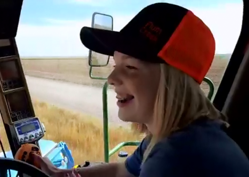 Amaya Ochs is a young farmer driving her family's combine.