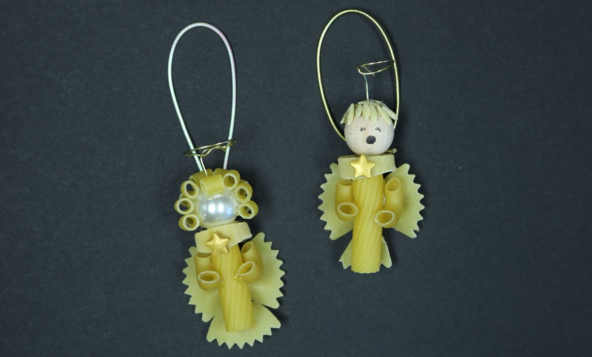 DIY Pasta angels created with wheat pasta, pearls and wire halos ready to hang on the tree