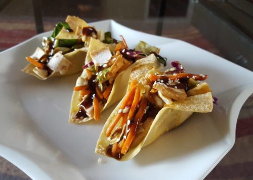 It's food fusion time! These wonton chicken tacos are perfect for an Asian food craving that takes less time than it would for delivery to come to your door.