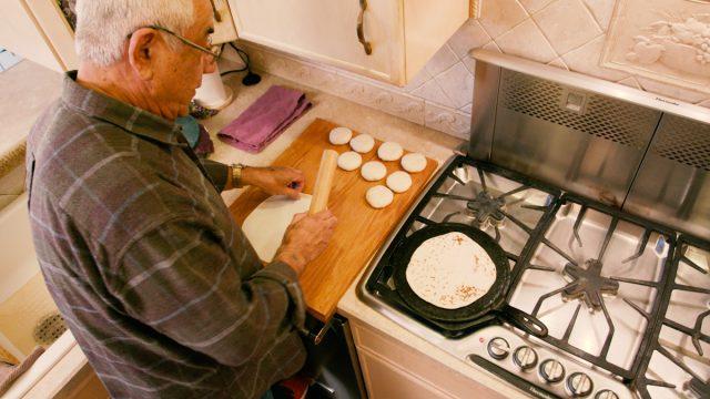 Tony rolling tortillas