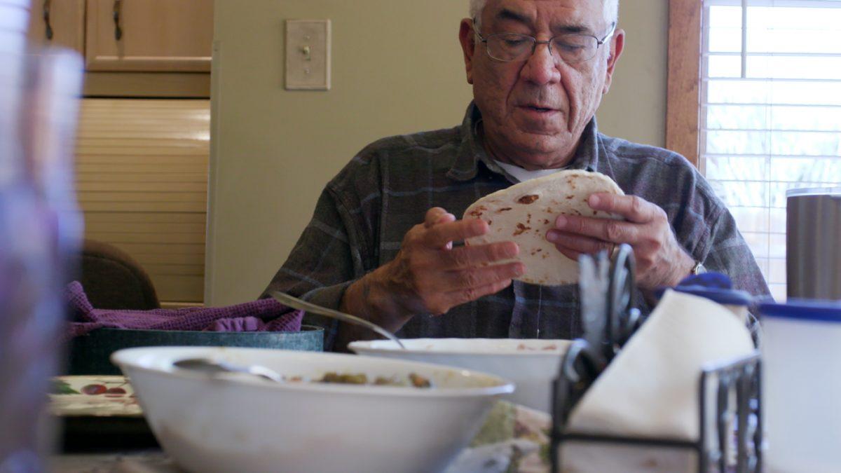 man holding tortilla