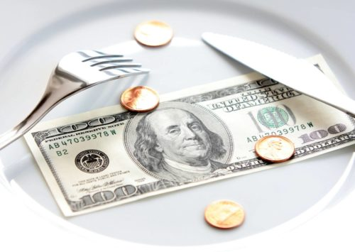 Photo: Money on dinner plate.