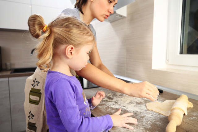 Photo: Mom and daughter baking in the kitchen.