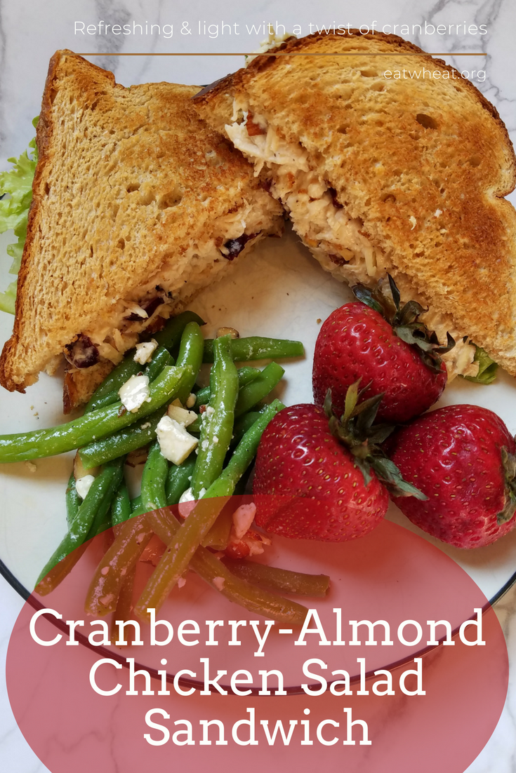 Cranberry-Almond Chicken Salad Sandwich - A refreshing and light chicken salad that includes a sweet twist of dried cranberries. Enjoy between two slices of whole wheat bread. eatwheat.org