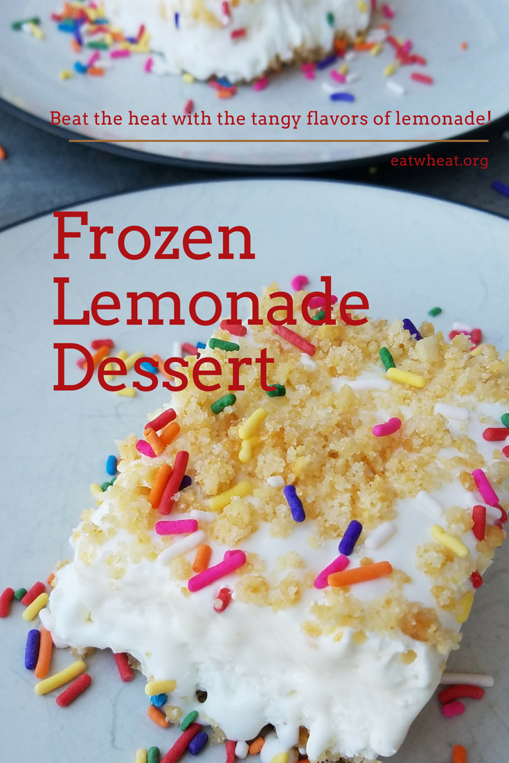 Frozen Lemonade Dessert - There's nothing like beating the heat with this tangy frozen lemonade dessert! This is the perfect treat to serve at summer get-togethers as you can complete all the prep the day before and simply pull out of the freezer and serve to guests! eatwheat.org