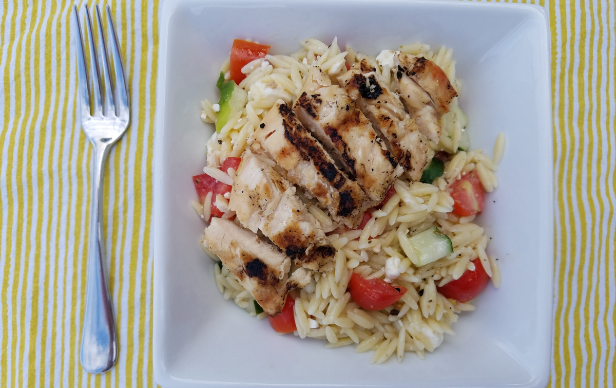 Photo: Greek orzo salad with grilled chicken.