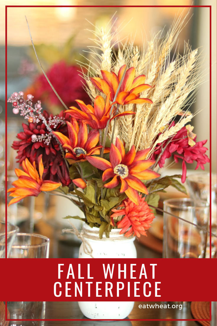 Decorate your Thanksgiving table with this fall centerpiece, which uses silk flowers and wheat | eatwheat.org