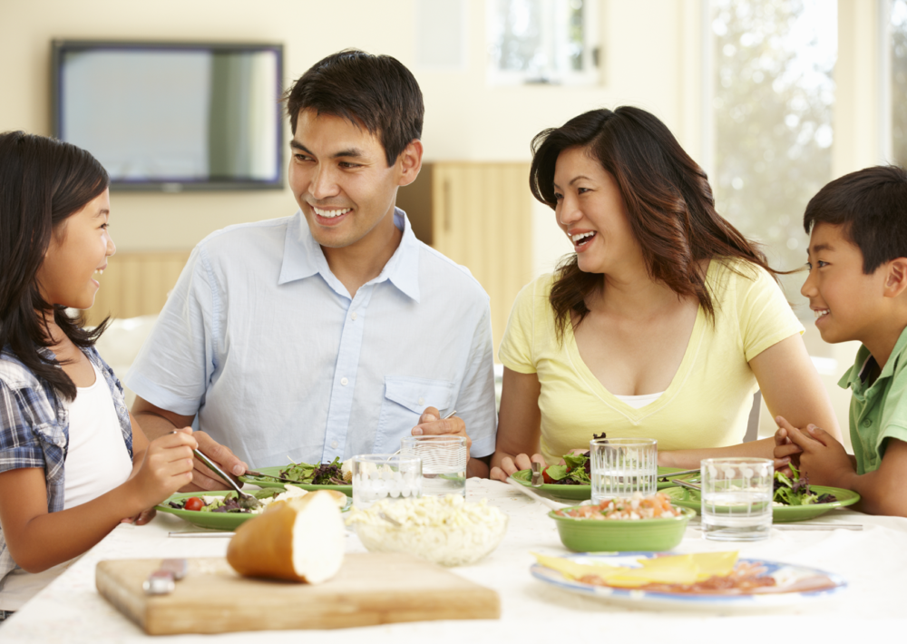 Family eating meal together. Eat Better. Eat Together.
