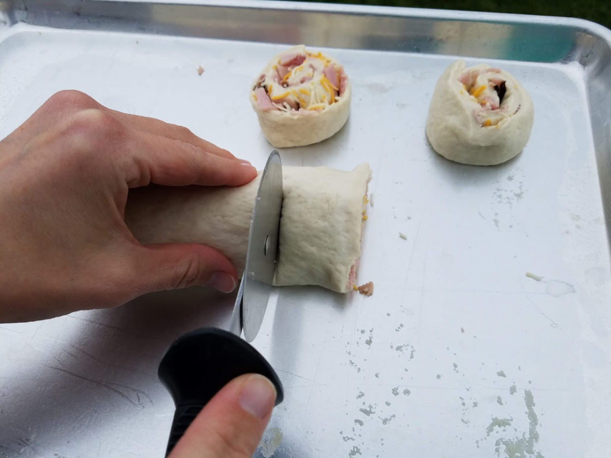 Photo: Ham and cheese pinwheels cutting.