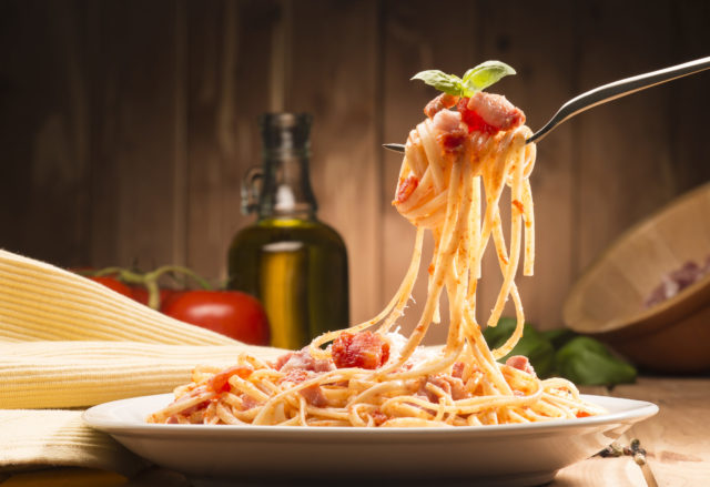 spaghetti with red sauce on fork