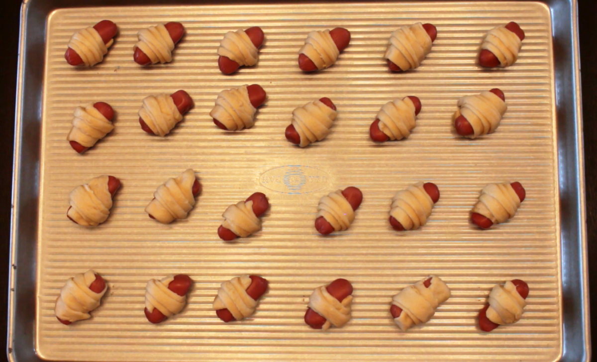 Photo: Pigs in a Blanket on baking sheet.