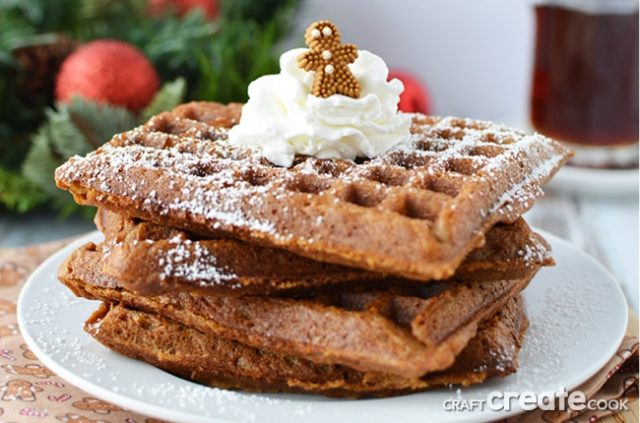 Gingerbread waffles on white plate with tiny gingerbread man on top. This is one of our unique waffle recipes