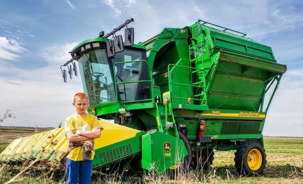 Image: Burgess son in front of combine.