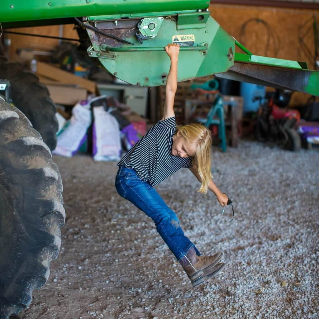 Photo: Burgess daughter playing on combine.