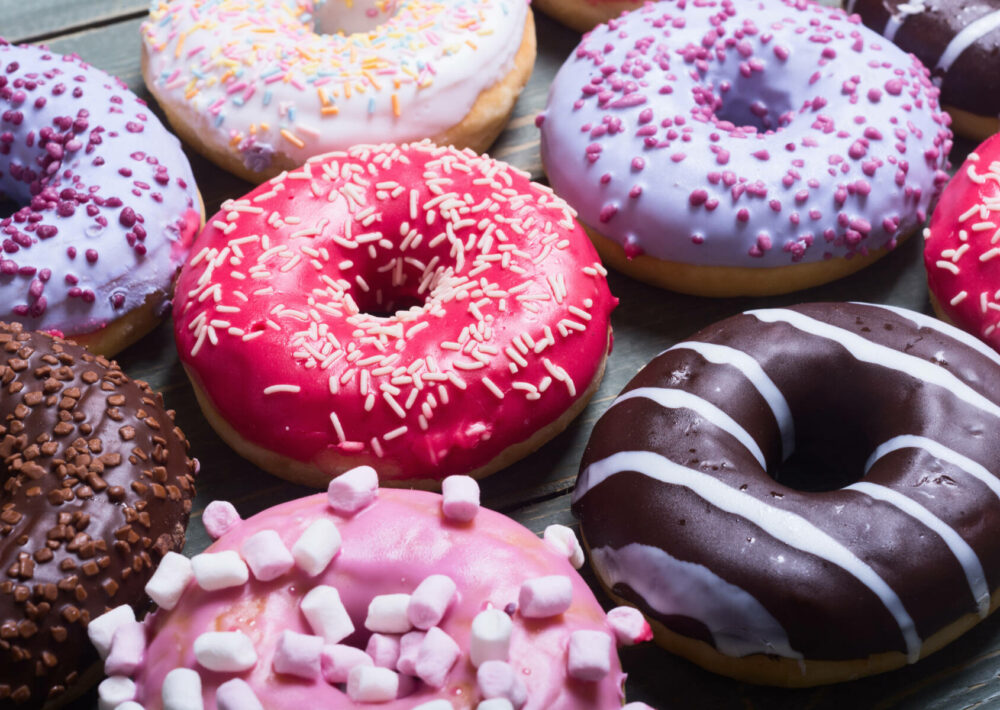 Colorful donuts arranged on a plate to celebrate National Donut Day